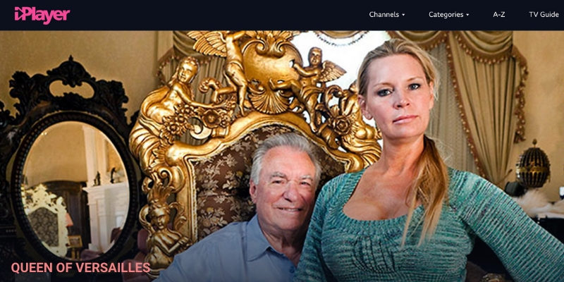 Movie still from QUEEN OF VERSAILLES. A Woman sits on a man's lap. The man sits of a gold throne